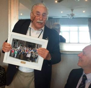 Charles Strasser med gruppe foto.