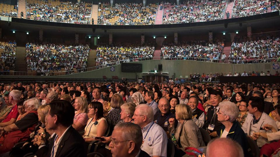 Convention goers await the beginning of Festival Night on 28 May in Seoul.
